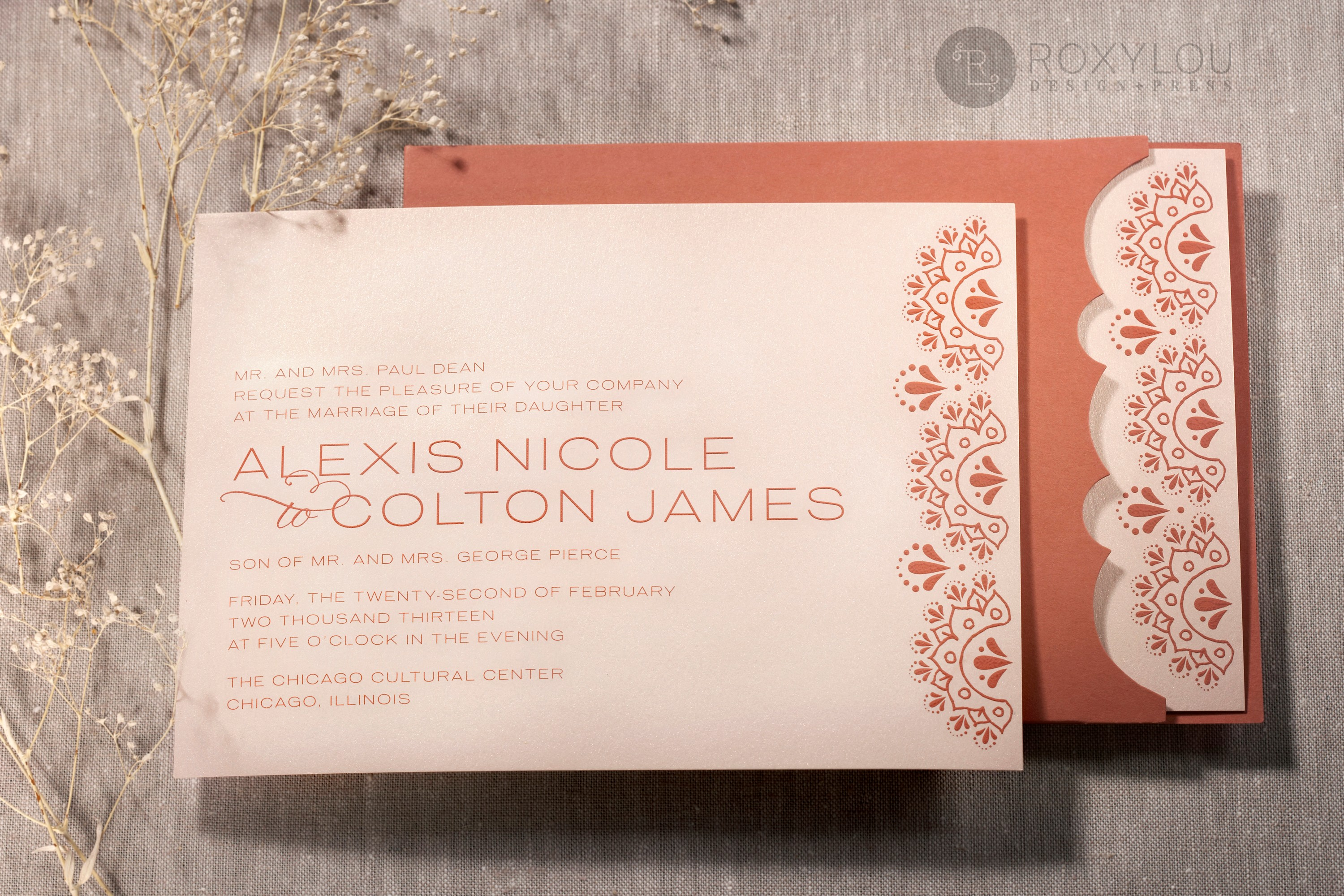 The Gypsy invitation suite features and engraved invitation card with a die-cut pocket that shows off the lovely invitation border.  Available in nearly any color combination, let us create something perfect for your event!