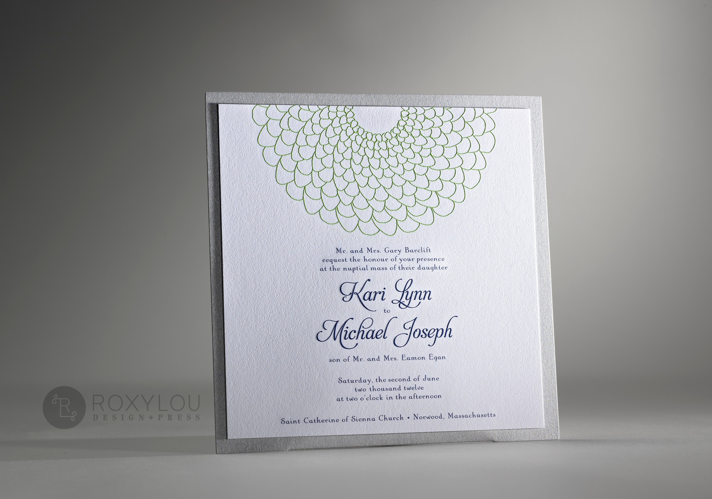 "The Blossom invitation suite includes a 2-color engraved invitation card mounted to a silver accent panel with an adorable pocket on the back to hold your inserts.  This simple and sweet 7"" square design is adorable in green, navy & silver or yellow, gray & silver as pictured,  but this design can be created in any color scheme."
