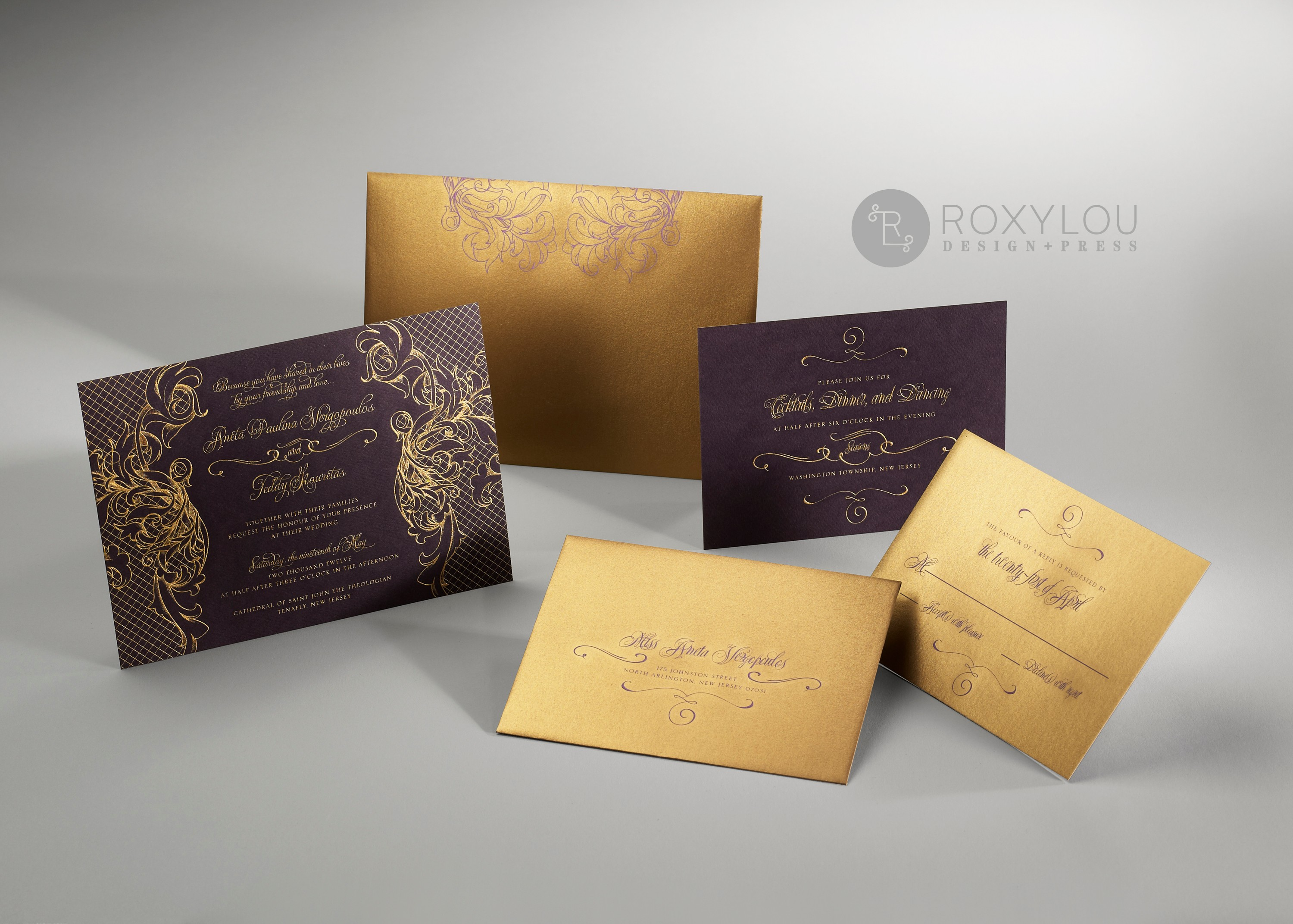 The stunning Regalia invitation suite features gold engraving on a contrast color card with decorative paper backing.  Your engraved inserts are tucked neatly into an engraved contrast wrap.  Very striking in eggplant and gold as pictured, but available in your choice of colors.