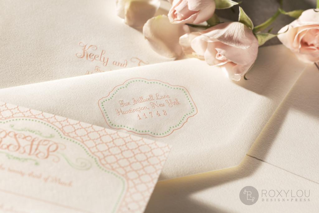 The Bliss invitation suite features 2-color engraved printing. Your stunning 5.5″ x 8.5″ die cut invitation and coordinating inserts are neatly wrapped by an engraved and die cut band that features a trendy geometric pattern with beautiful scroll-work. Pale pink and mint green are delightful on pearl white paper, but this design can be created in any color scheme.