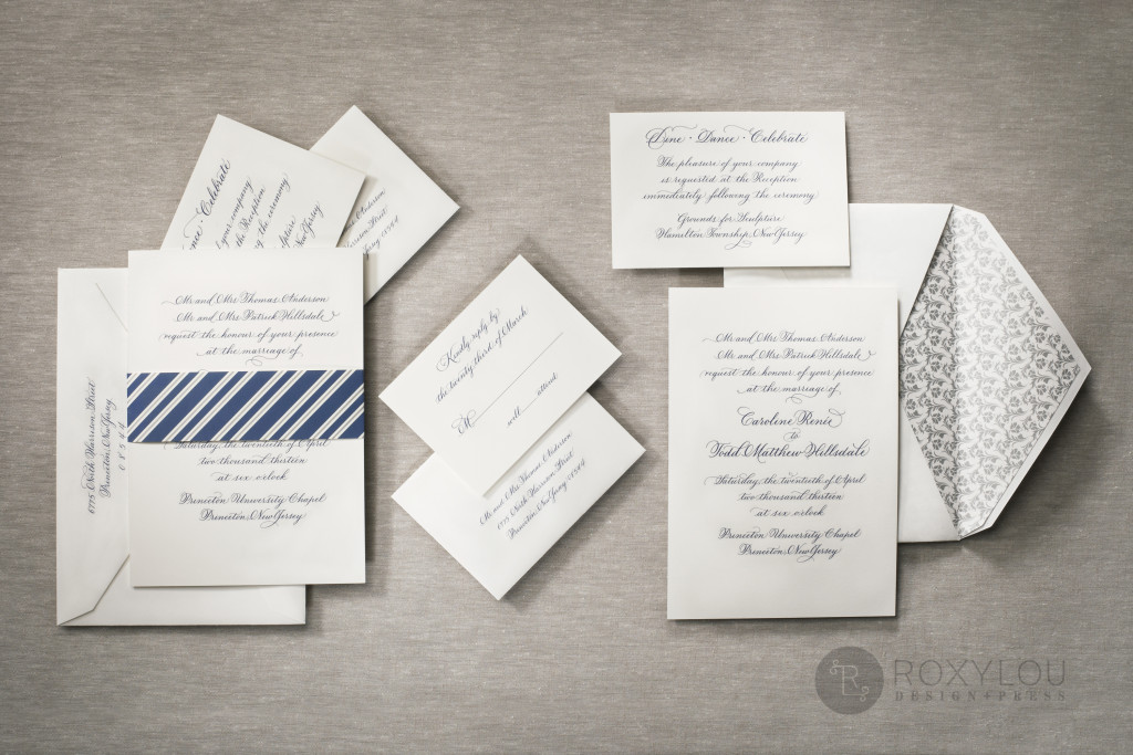 The Capital invitation suite features one-color engraving on a large 5.5″ x 8.5″ heavy ecru stock. Silver edge painting adds a very special finishing touch. Invite and inserts are held neatly together with a striped wrap, then tucked into a beautifully lined inner envelope. For an extra special statement, have this design hand lettered by a professional calligrapher! Stunning in navy and silver, but available in your choice of colors.