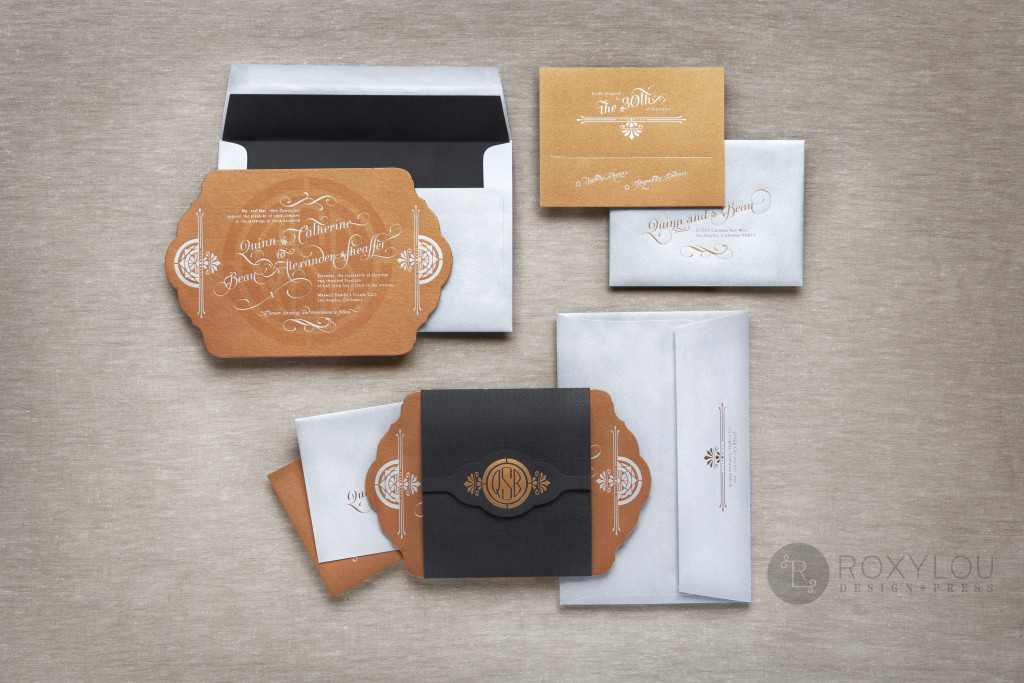 The Empire invitation suite features a foil stamped invitation and inserts tucked neatly inside a foil stamped, embossed, and die cut wrap. The unique shape of this large 5.5″ x 8.5″ is truly a standout for your formal affair. Stunning in the metallic copper and metallic burgundy options shown here, but let us create this in your own color scheme.