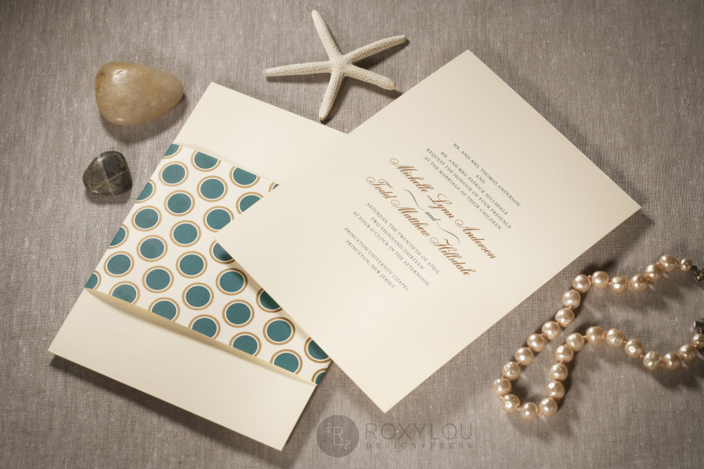 The Hampton invitation suite features a traditionally formal 2-color engraved invitation card with a dotted wrap, engraved outer envelope, and a beautiful stripe-lined inner envelope. Stunning in turquoise and gold on ecru paper, but we'd love to customize this invitation's colors to coordinate with your own wedding. Hampton_detail_1