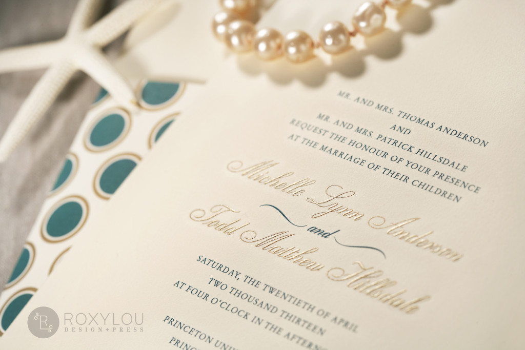 The Hampton invitation suite features a traditionally formal 2-color engraved invitation card with a dotted wrap, engraved outer envelope, and a beautiful stripe-lined inner envelope. Stunning in turquoise and gold on ecru paper, but we'd love to customize this invitation's colors to coordinate with your own wedding. Hampton_detail_2