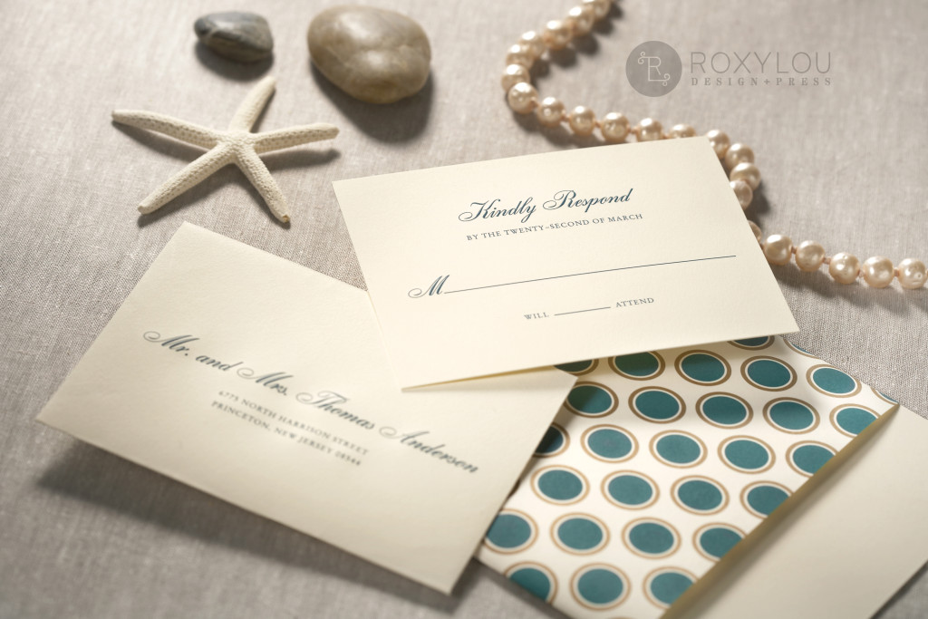 The Hampton invitation suite features a traditionally formal 2-color engraved invitation card with a dotted wrap, engraved outer envelope, and a beautiful stripe-lined inner envelope. Stunning in turquoise and gold on ecru paper, but we'd love to customize this invitation's colors to coordinate with your own wedding. Hampton_detail_3