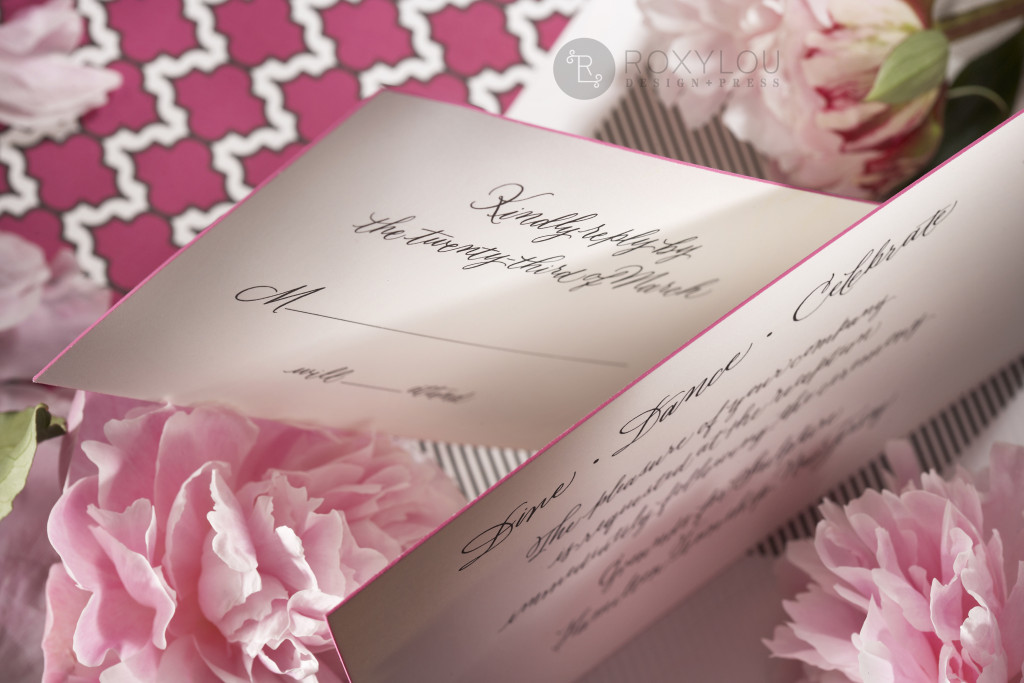 The Moxie invitation suite features a stunningly thick engraved invitation card with contrast painted edge. Invite and inserts are neatly tucked into a geometric pattern wrap and then into a lined inner envelope and an engraved outer envelope. Truly stunning in fuchsia and black, but can be created in any color scheme. Moxie_detail_2