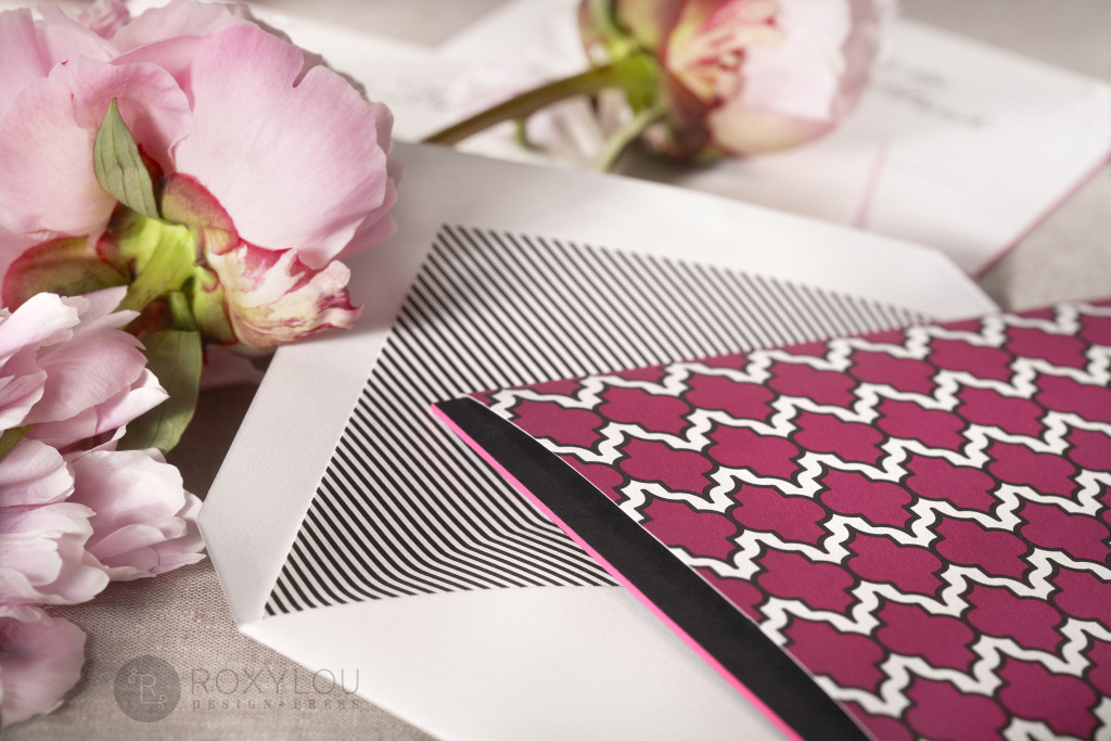 The Moxie invitation suite features a stunningly thick engraved invitation card with contrast painted edge. Invite and inserts are neatly tucked into a geometric pattern wrap and then into a lined inner envelope and an engraved outer envelope. Truly stunning in fuchsia and black, but can be created in any color scheme. Moxie_detail_3