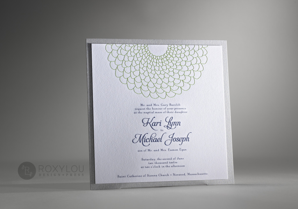 The Blossom invitation suite includes a 2-color engraved invitation card mounted to a silver accent panel with an adorable pocket on the back to hold your inserts. This simple and sweet 7″ square design is adorable in green, navy & silver or yellow, gray & silver as pictured, but this design can be created in any color scheme.