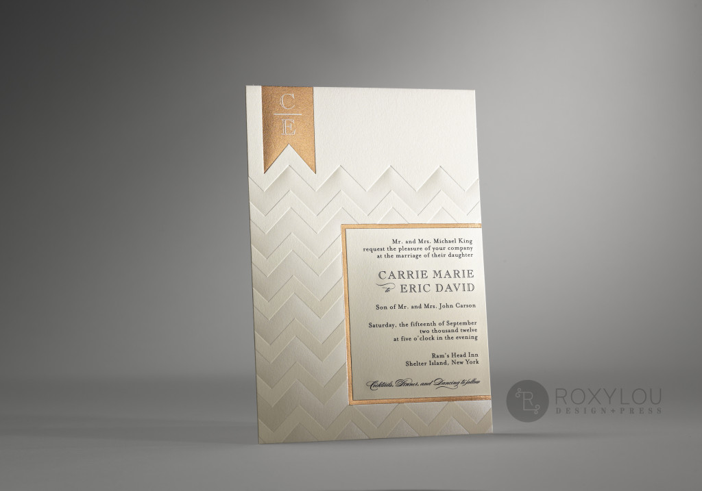 The Chevron invitation suite features a foil stamped geometric pattern with engraved text. 2-color invitation and inserts are all tucked neatly into an engraved pocket, and then mailed in a beautifully lined envelope. This contemporary design looks elegant and classic in copper on ecru, or bold and modern in green and black. Make it truly unique in your own wedding color scheme.