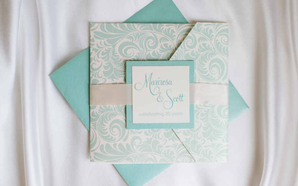 Pale green and blush pocket wedding invitation.