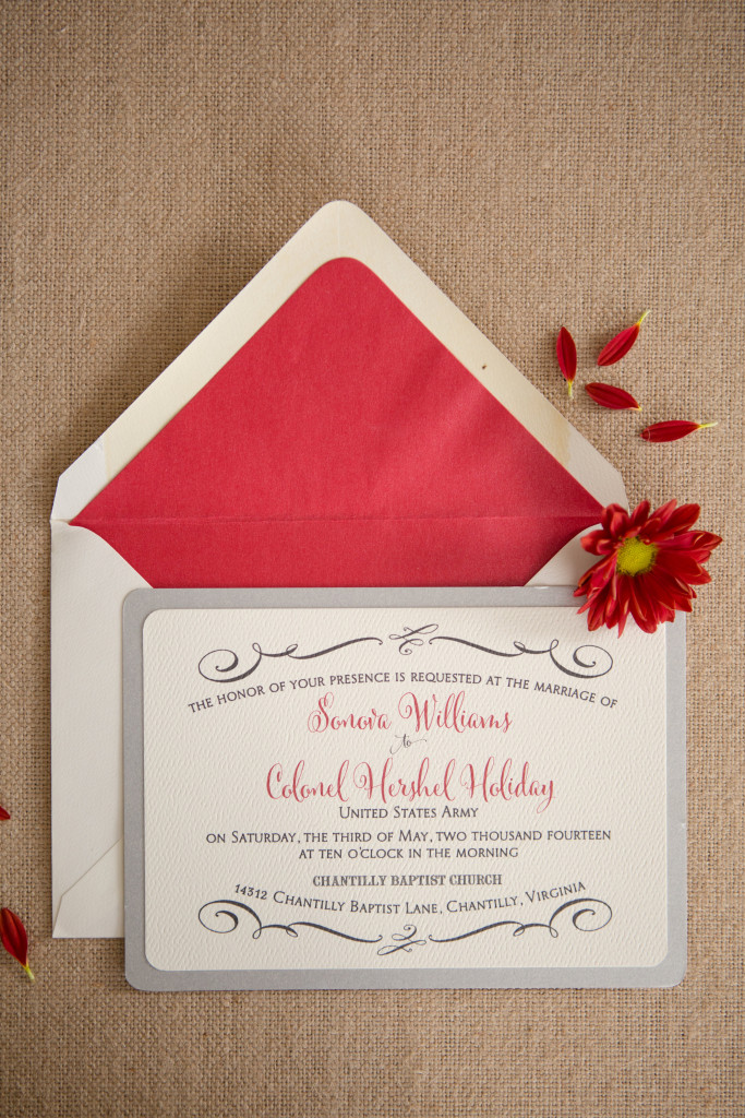 Silver and ivory is beautifully accented by pops of red text on this contemporary wedding invitation by Staccato.