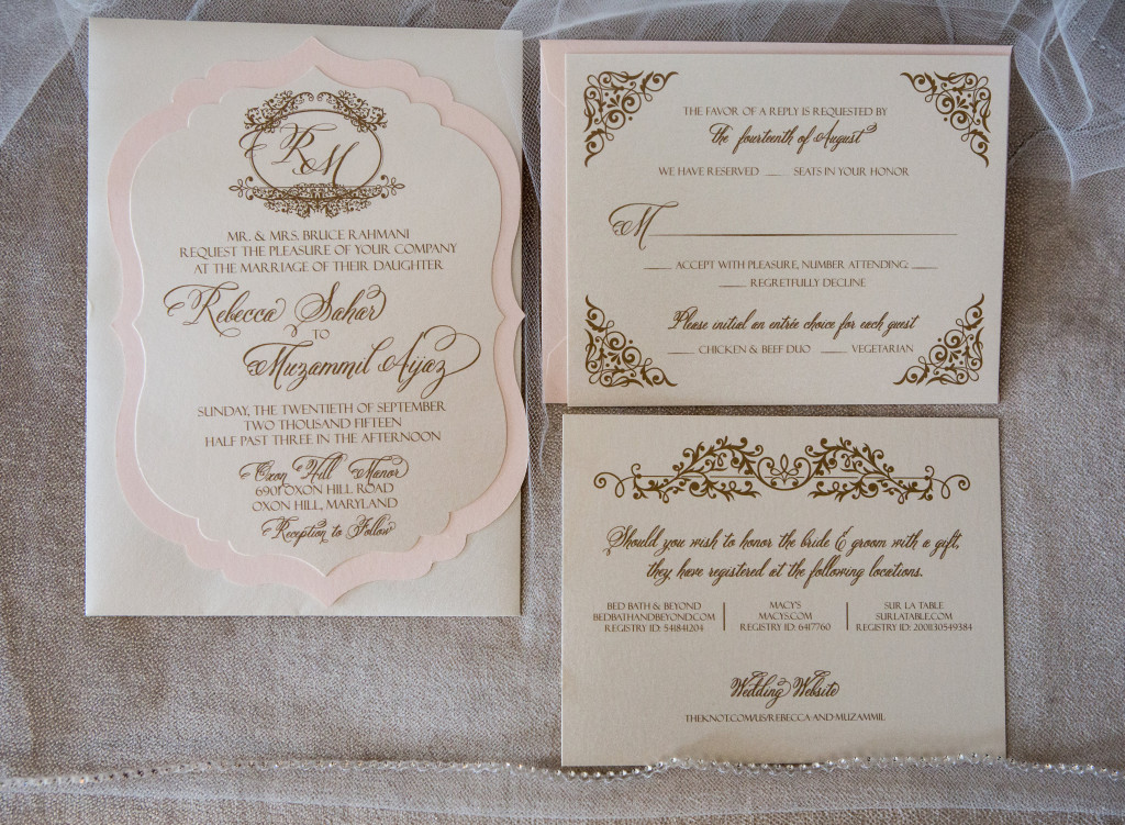 Elegant and ornate, this blush, ivory, and gold hued wedding invitation by Staccato makes a stunning first impression!