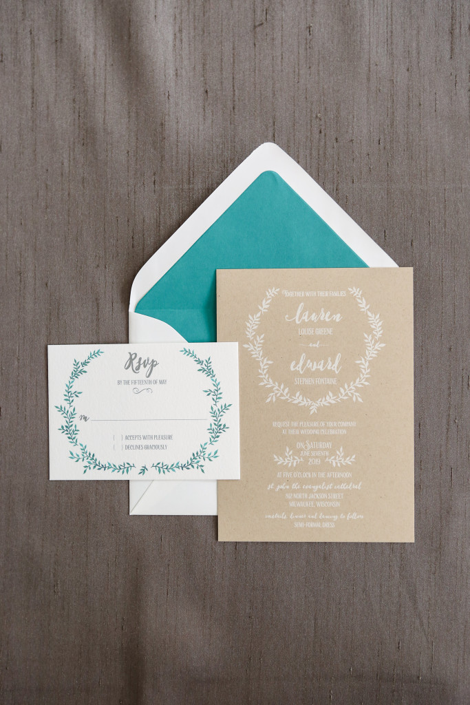 White ink on kraft paper makes this rustic invitation a true standout!