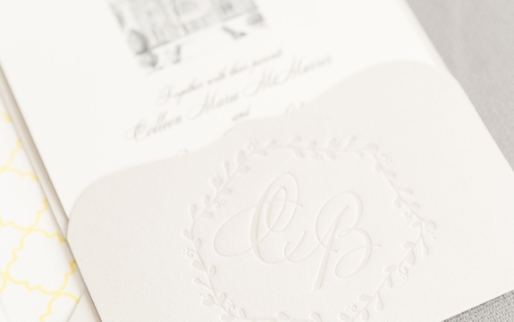 """handrawn artwork by the bride's father is the highlight of this beautiful and personal custom wedding invitation.  The couple's initials are letterpresses into a pretty scalloped pocket and a subtle yellow pattern creates a gentle """"pop"""" on the envelope liner."""