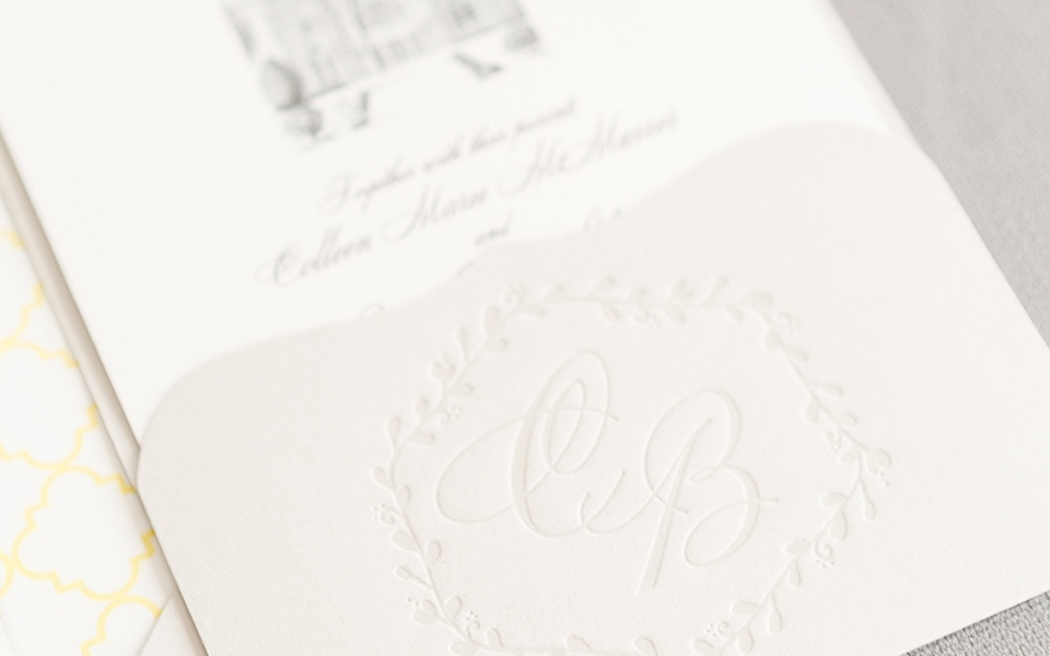 "handrawn artwork by the bride's father is the highlight of this beautiful and personal custom wedding invitation.  The couple's initials are letterpresses into a pretty scalloped pocket and a subtle yellow pattern creates a gentle ""pop"" on the envelope liner."