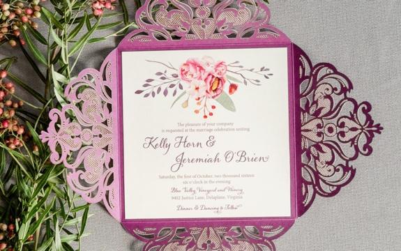 Purple square laser cut folio envelopes a fall colored floral embellished wedding invitation.