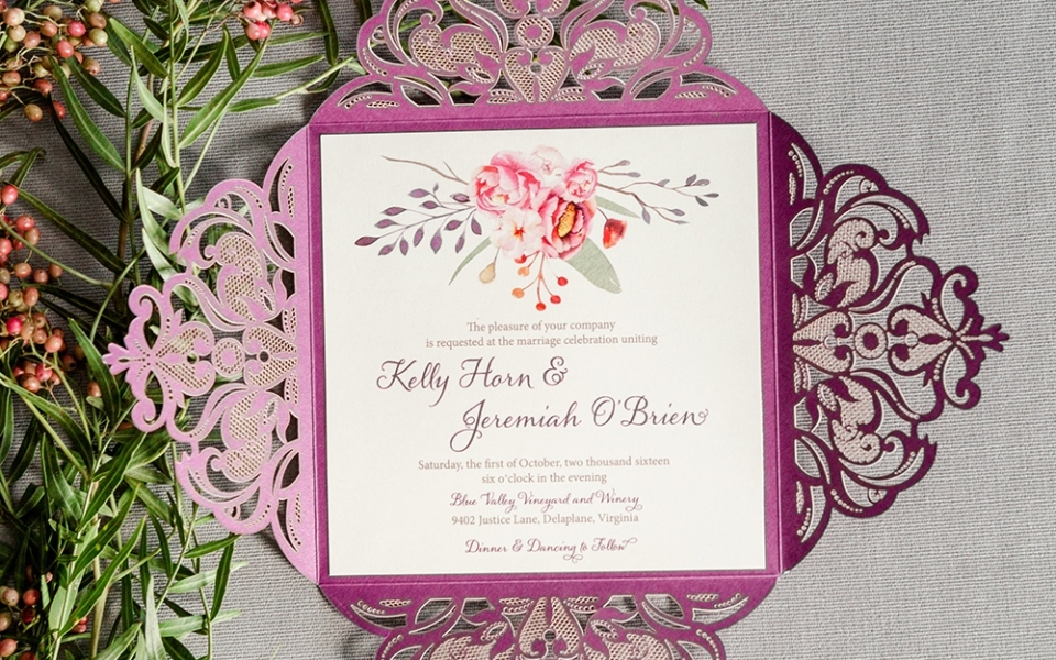 Purple square laser cut folio envelopes a fall colored floral embellished wedding invitation.