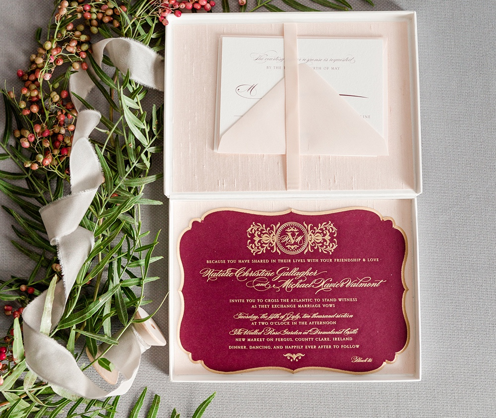 Ultra thick wine colored invitation is engraved in gold and features gold painting on a beveled edge.  Mailed in a luxurious silk-lined box.