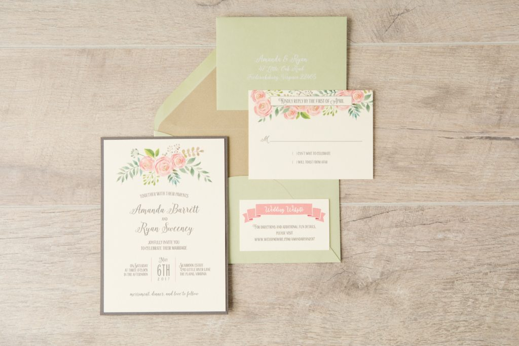 floral patterned wedding invitation layered onto a beautiful gray back pocket. Sage green envelopes with metallic gold leaf envelope liners.