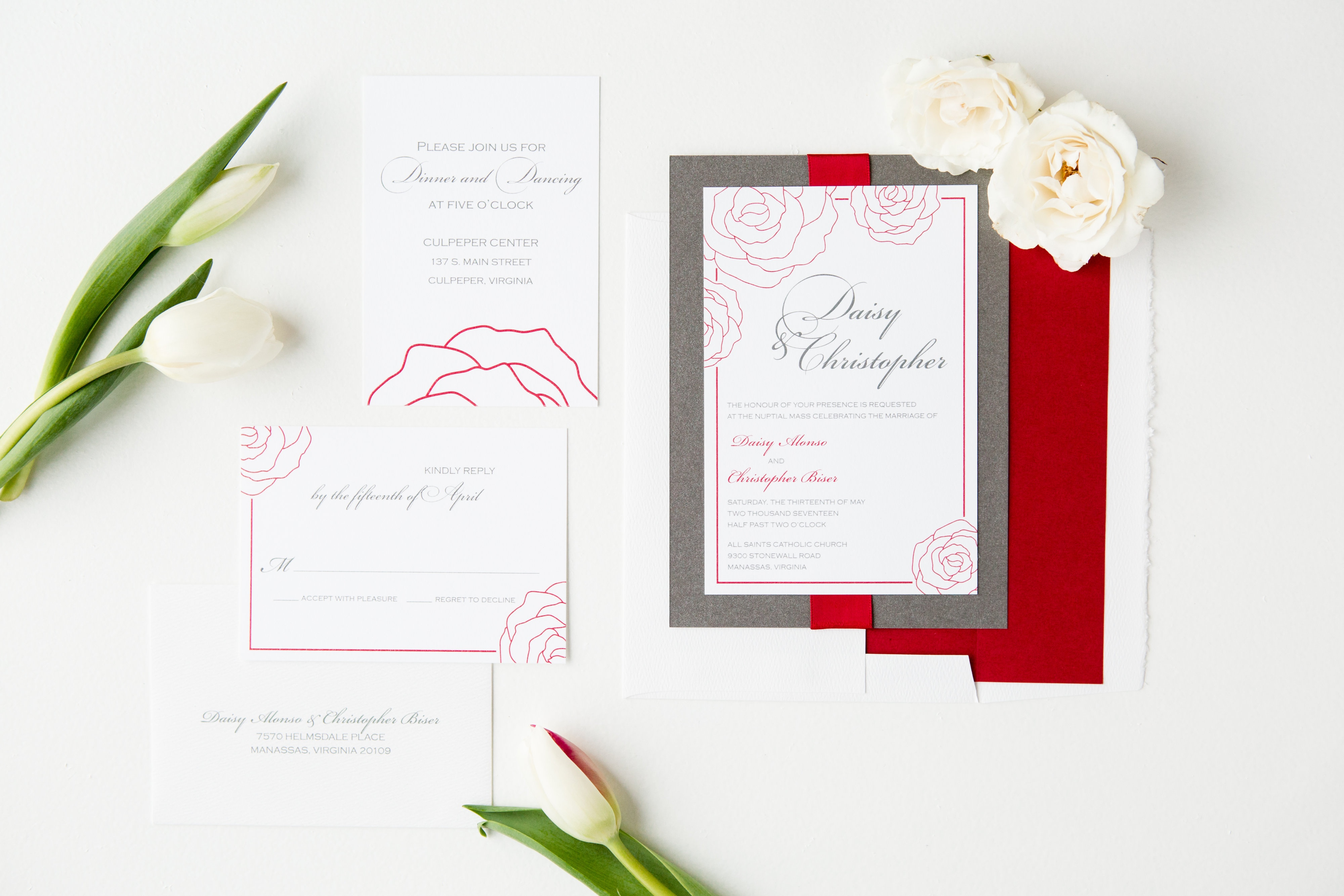 Rose outlines in red, shimmering gray backing layer, red satin ribbon accent. Thermography wedding invitation.
