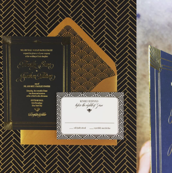 A bold, black wedding invitation is stunning with gold foil frame and text.  Paired with a gold envelope with a geometric liner, this is a contemporary art deco design.