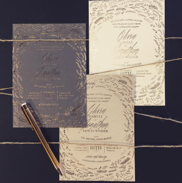 Gold foil makes a statement on any color paper!  Seen here on gray, ivory, or kraft.  The Coulet invitation features a stunning swirl of branches and leaves as a frame for your invitation text.