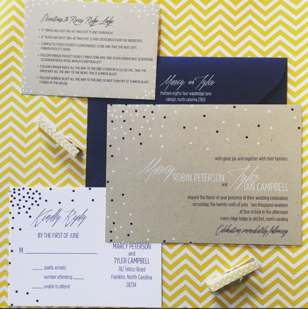 Kraft colored paper is adorned with navy and white ink to create a truly unique wedding invitation!  Accented with a navy envelope with white ink.