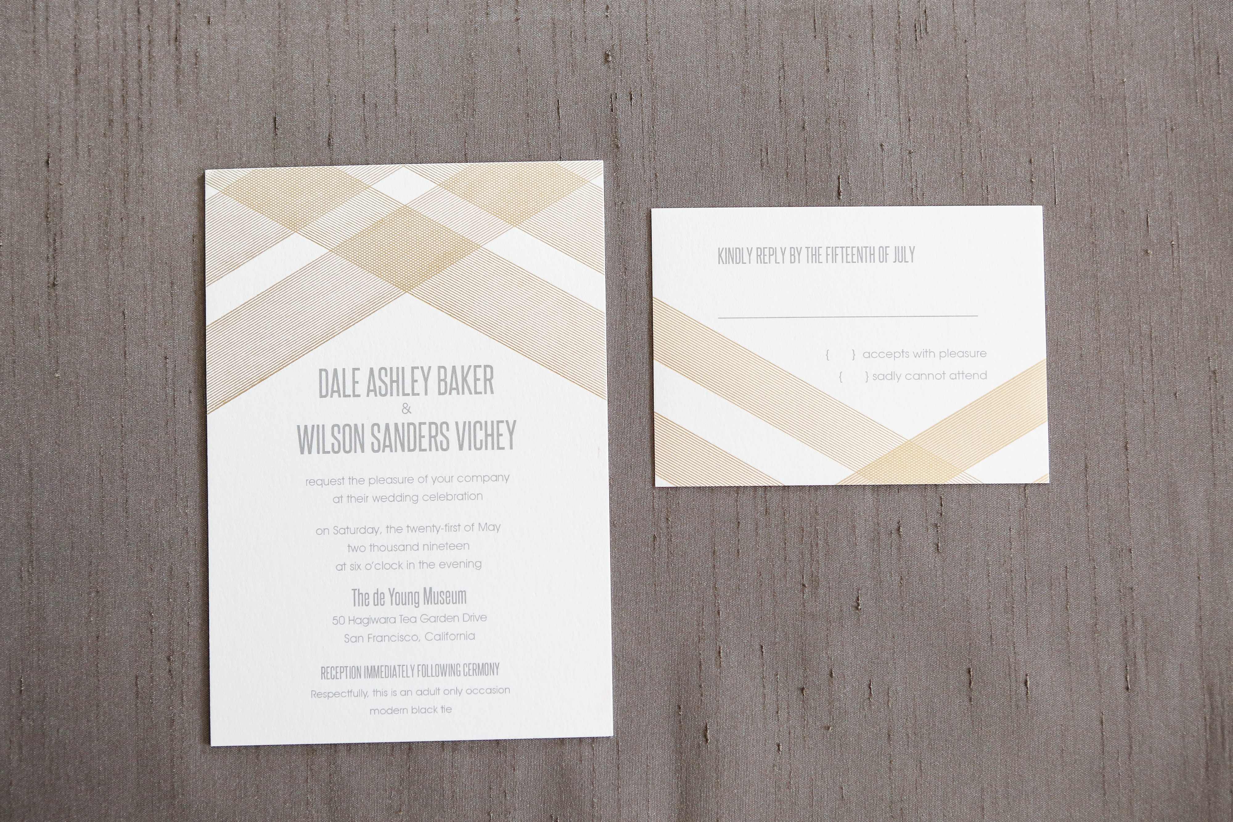 Bold lines in matte gold foil make quite a statement on this stunning wedding invitation suite.