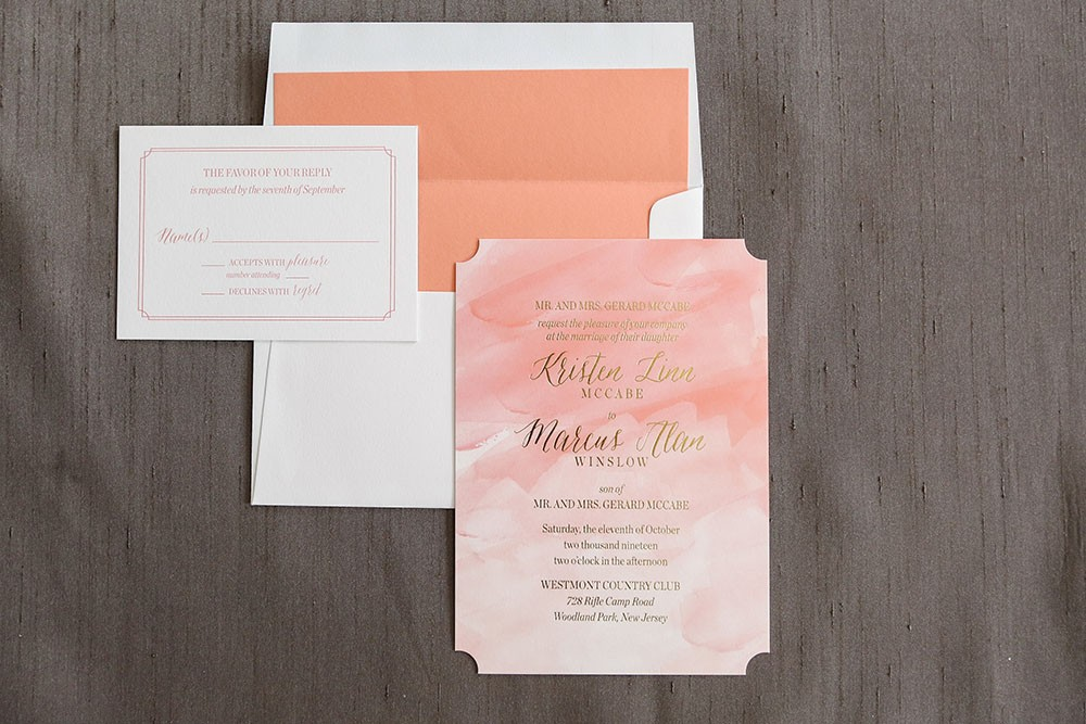 Elegant foil stamping on a beautiful watercolor background makes this a stunning introduction to your special day!