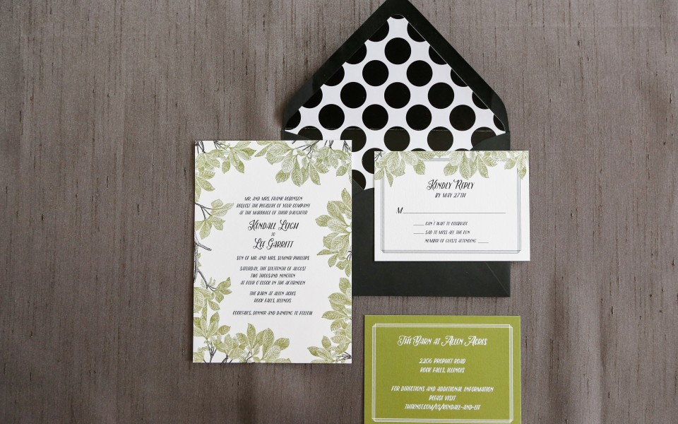 Green leaves adorn the edges of this pretty little invitation suite.  Make it truly stand out with a bold polka dot envelope liner!