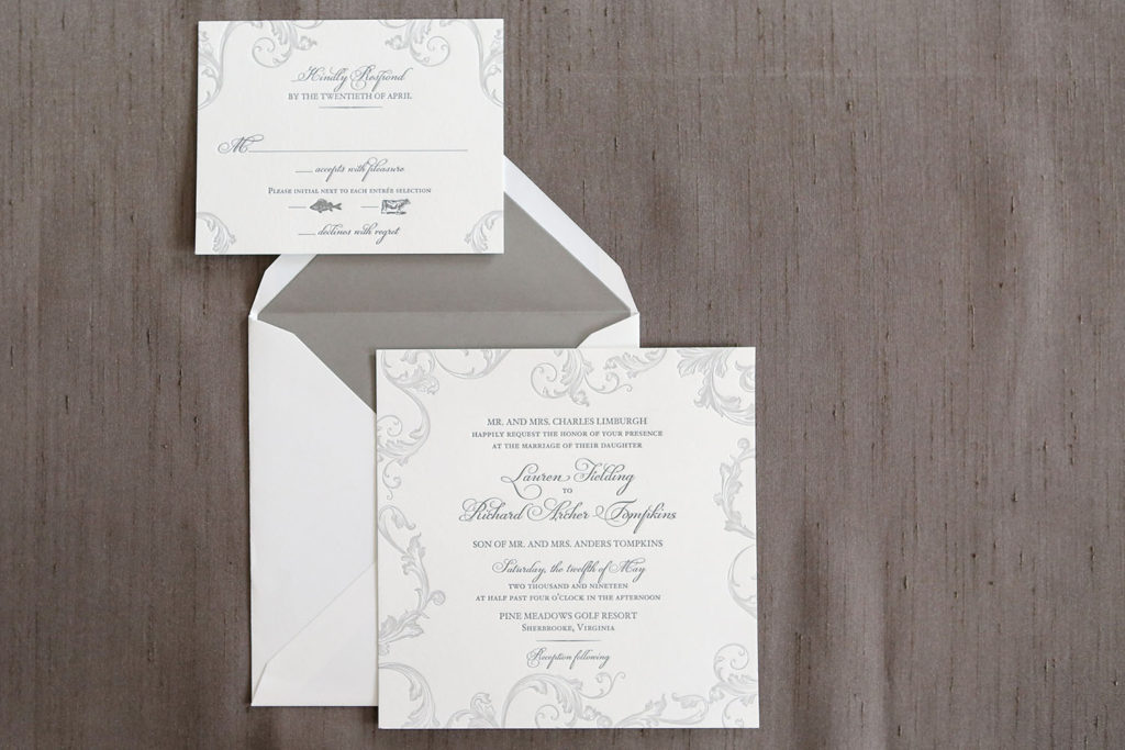 2 tones of subtle gray give a traditional feel to the contemporary square shape of this wedding invitation.