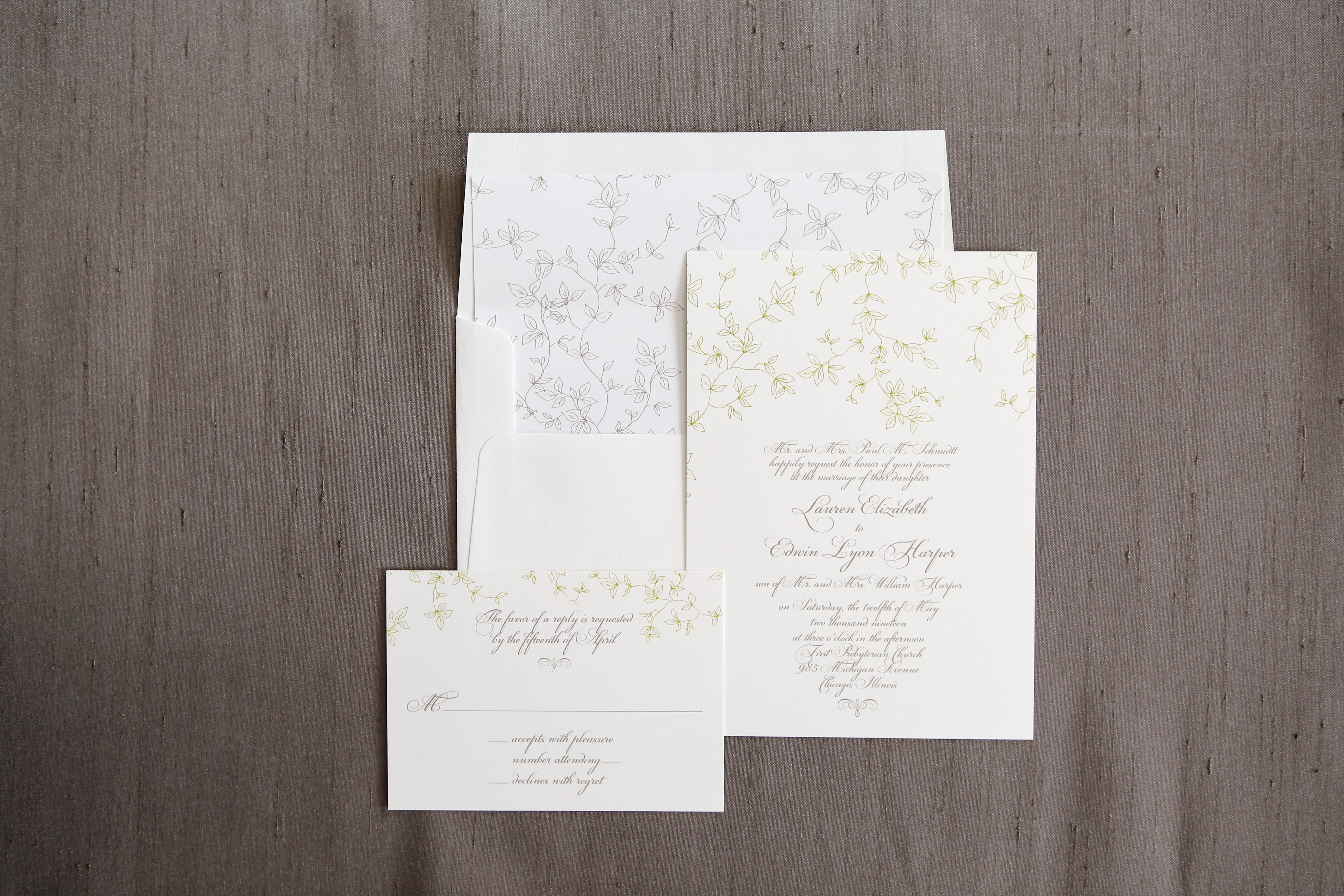 This 2-color thermography wedding invitation is delicate and ethereal.  Green vines gently frame the top of the page, while a formal script announces your event.