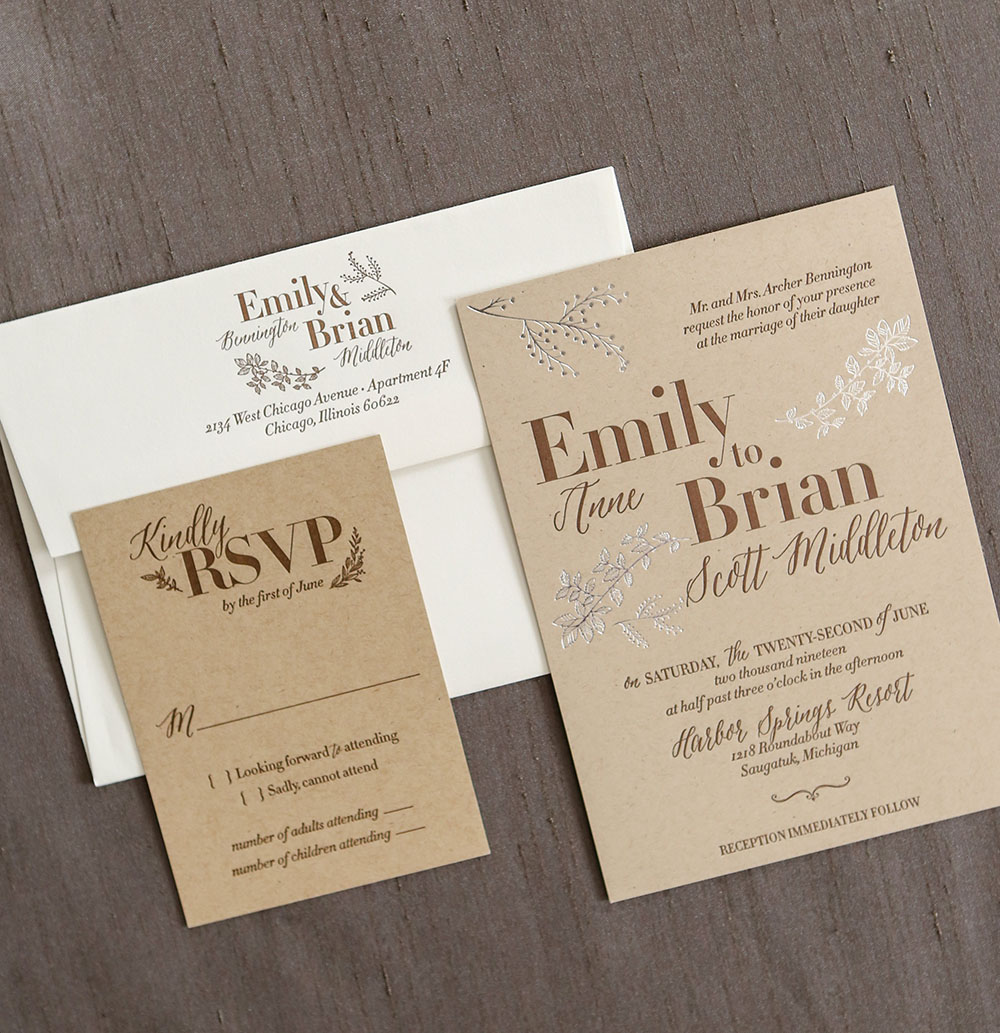 Foil and letterpress wedding invitation on kraft paper.