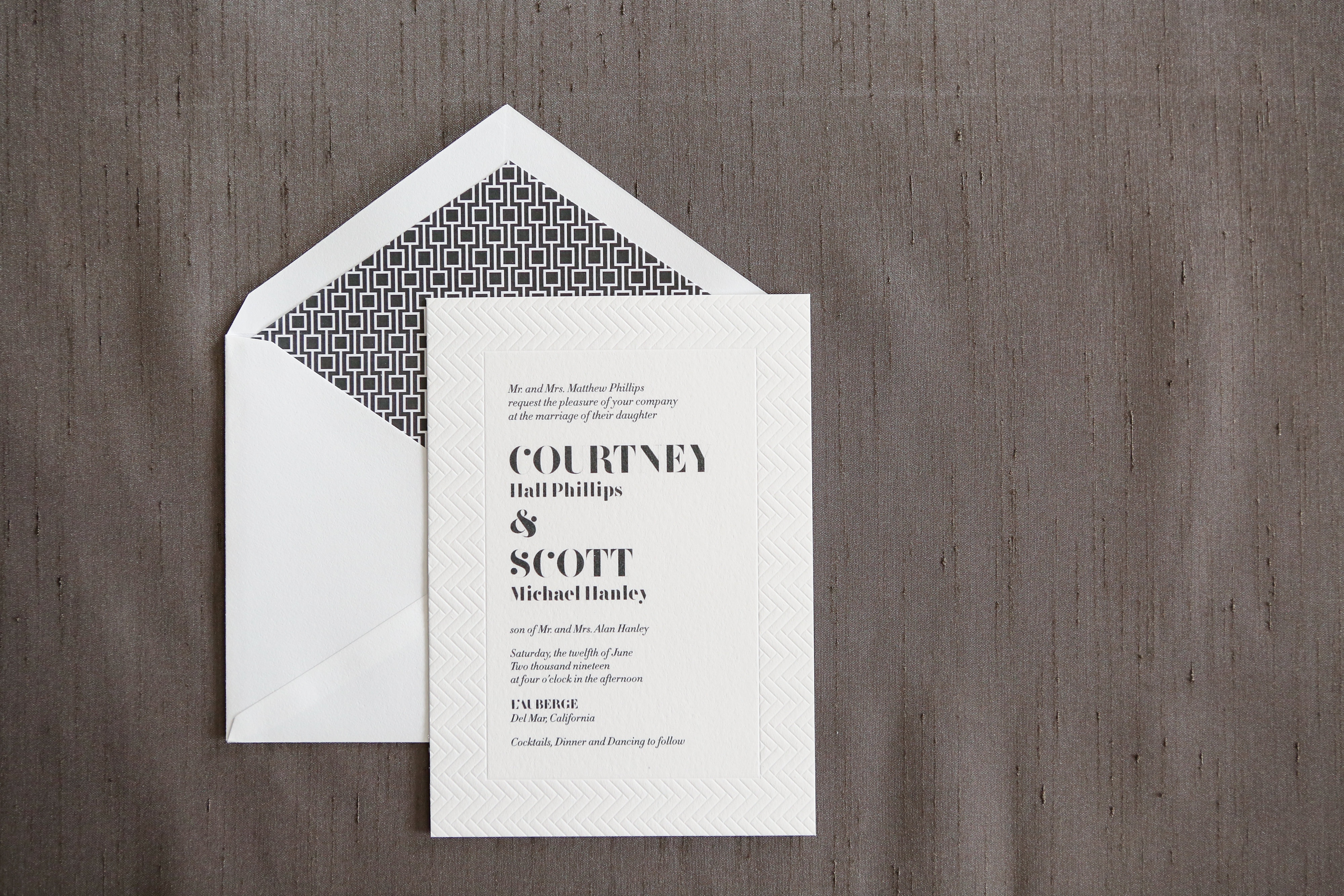 The Alinea Wedding Invitation Suite available at Staccato features 1 color thermography with blind impression border, bold text, and a geometric envelope liner.  Contemporary yet formal, this invitation makes a bold statement.
