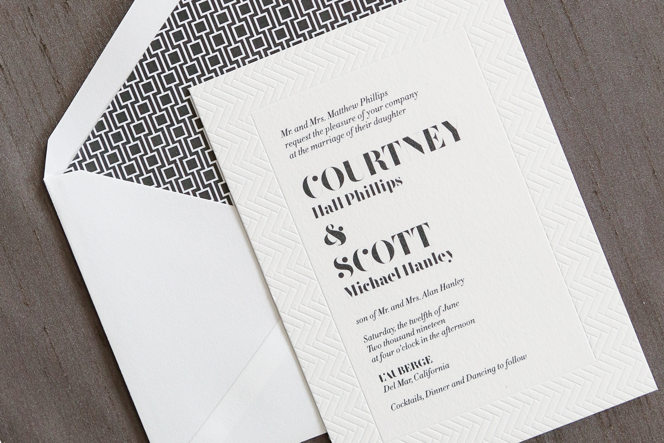 Alinea Wedding Invitation Suite available at Staccato features 1 color thermography with blind impression border, bold text, and a geometric envelope liner. Contemporary yet formal, this invitation makes a bold statement.