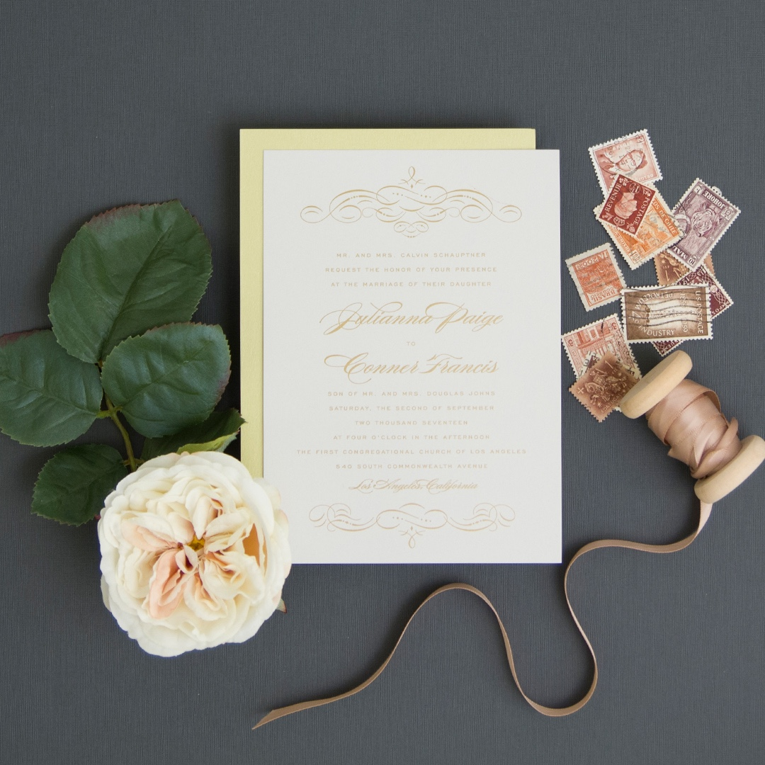 Cashmere invitation by Envelopments uses soft and subtle calligraphic embellishments to frame a formal and traditional text setting.