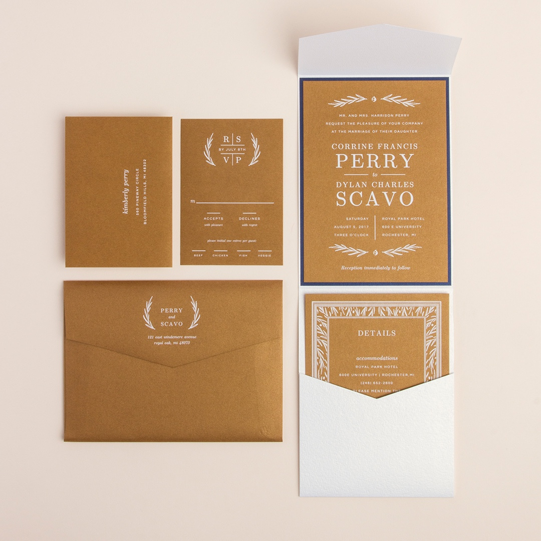 Autumn Romance layered pocketfold wedding invitaiton by Envelopments features bold metallic gold stock with white ink printing and navy accents.