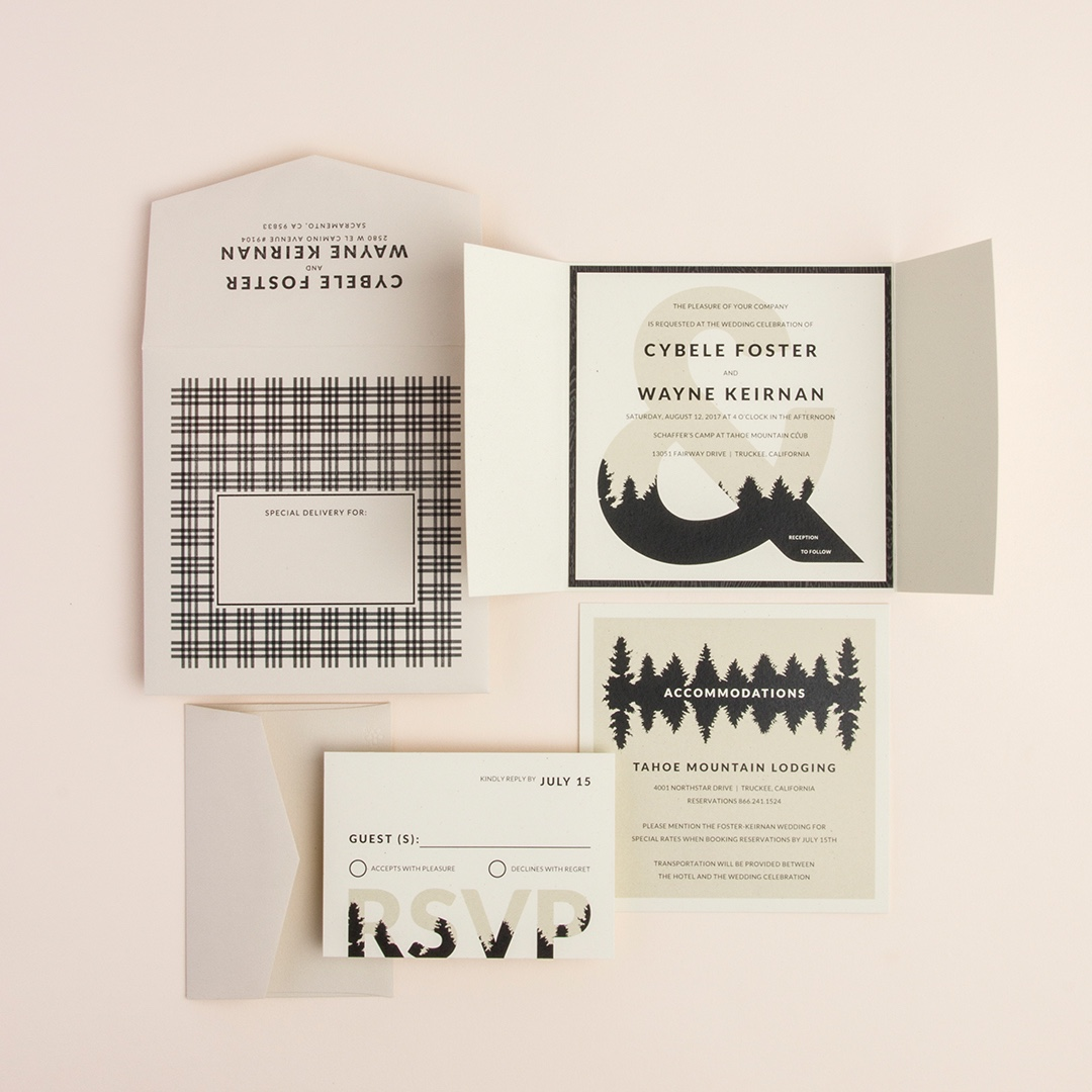 Forester gatefold wedding invitation by Envelopments features a bold ampersand with silhouettes of a tree line.  Perfect for a mountain wedding.
