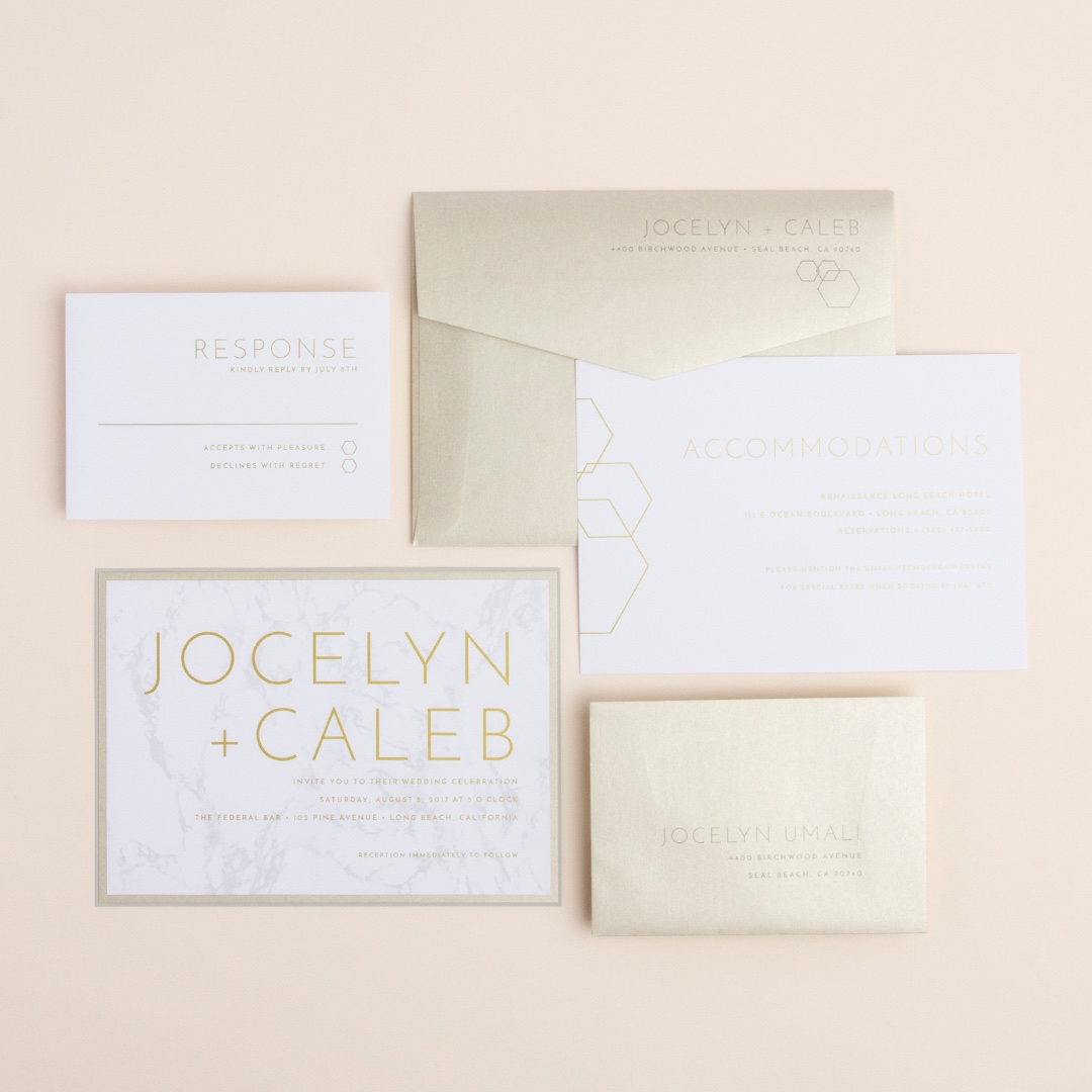 Contemporary Marble layered wedding invitation by Envelopments features the most on-trend look of carrera in the background and accents of crystal shapes.  Truly stunning with accents of metallic papers.