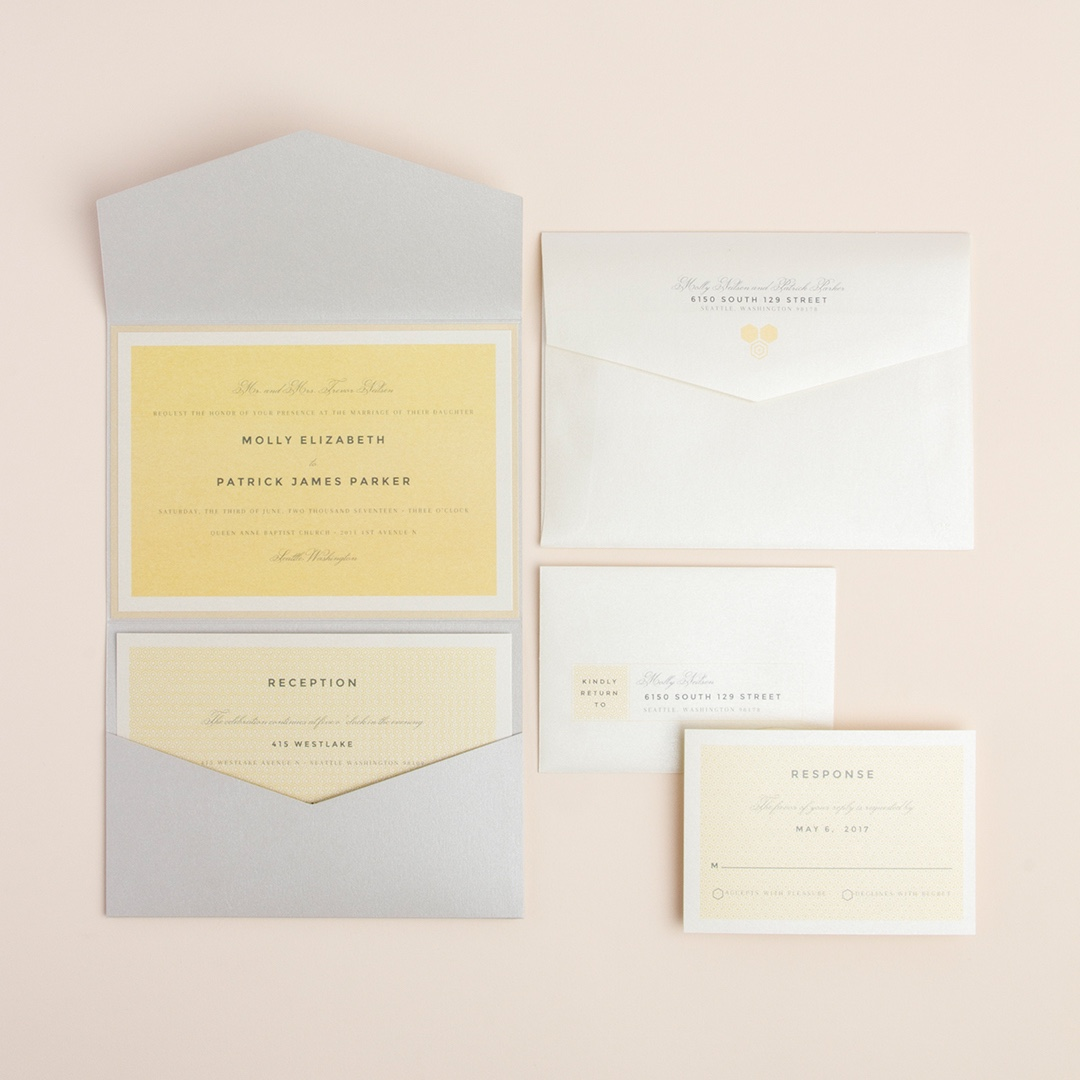 Petite Hex Pocketfold Wedding Invitation by Envelopments features a gentle yellow hue as the background.  Subtle grays complete the look.