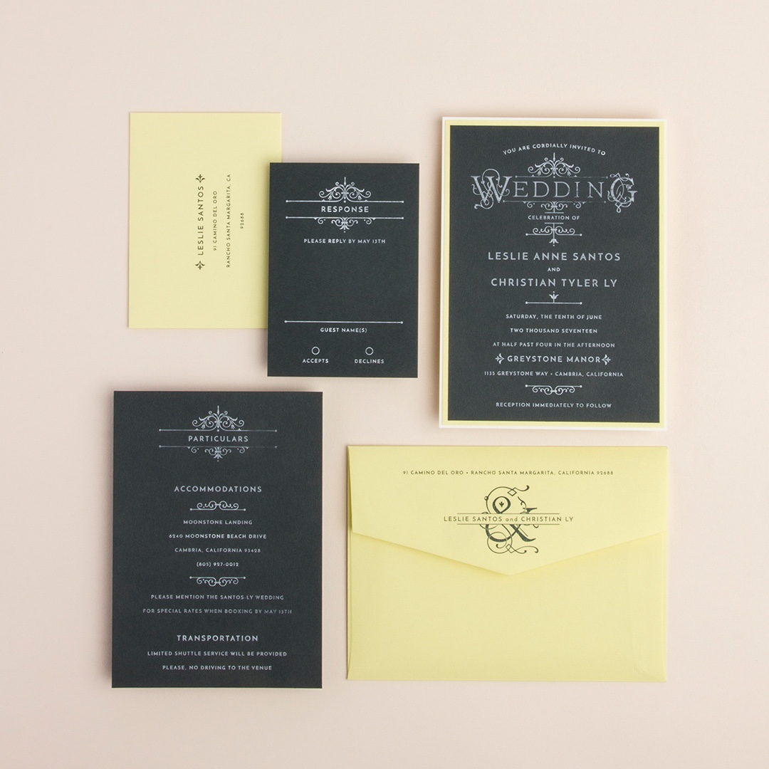 French Quarter wedding invitation features bold white-on-black lettering and pale yellow accents.