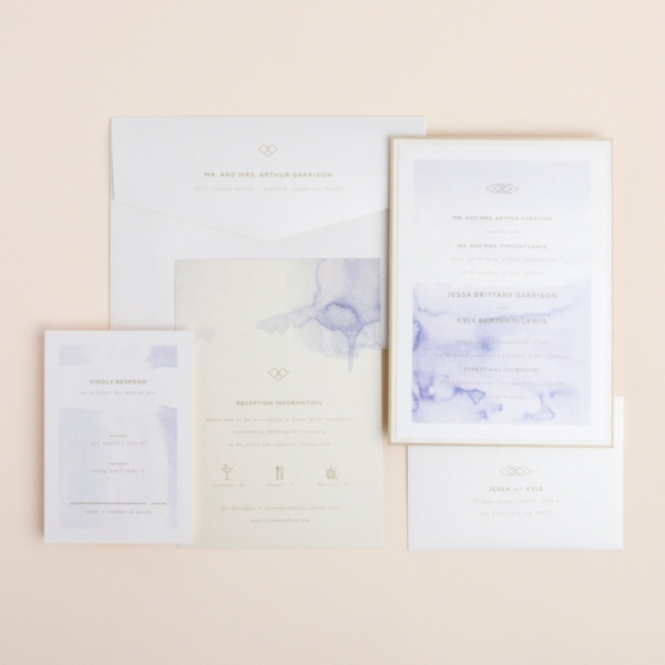 Serendipity layered wedding invitation by Envelopments features a lovely watercolor background and pretty gold accents.