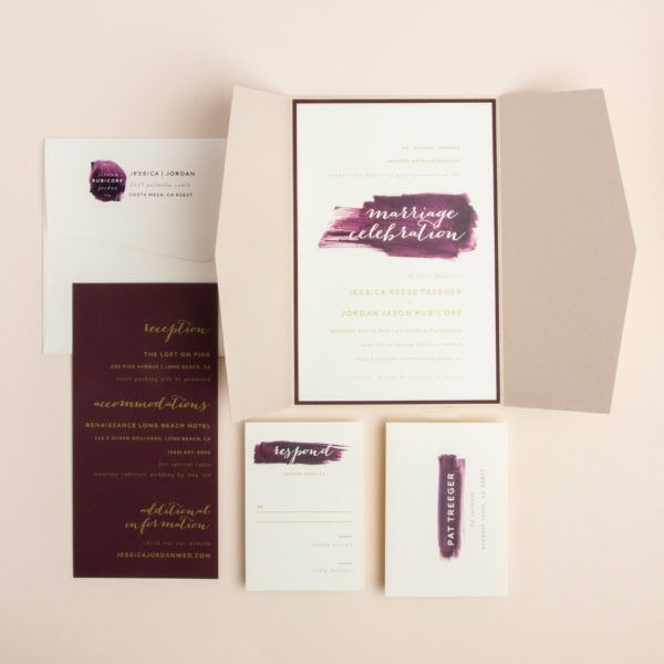 Painted Love Gatefold Wedding Invitation by Envelopments showcases a beautiful calligraphy script inside graceful watercolor brushstrokes.