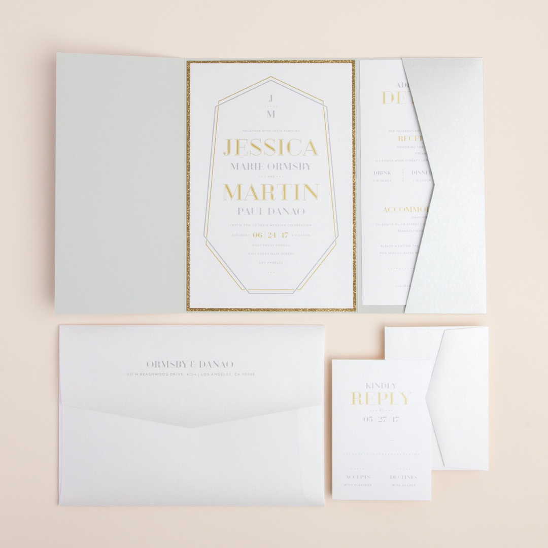 Crystal Luxe pocketful wedding invitation by Envelopments uses the popular crystal shape as a frame for stunningly set text.  It all layers beautifully into a silver metallic pocket.