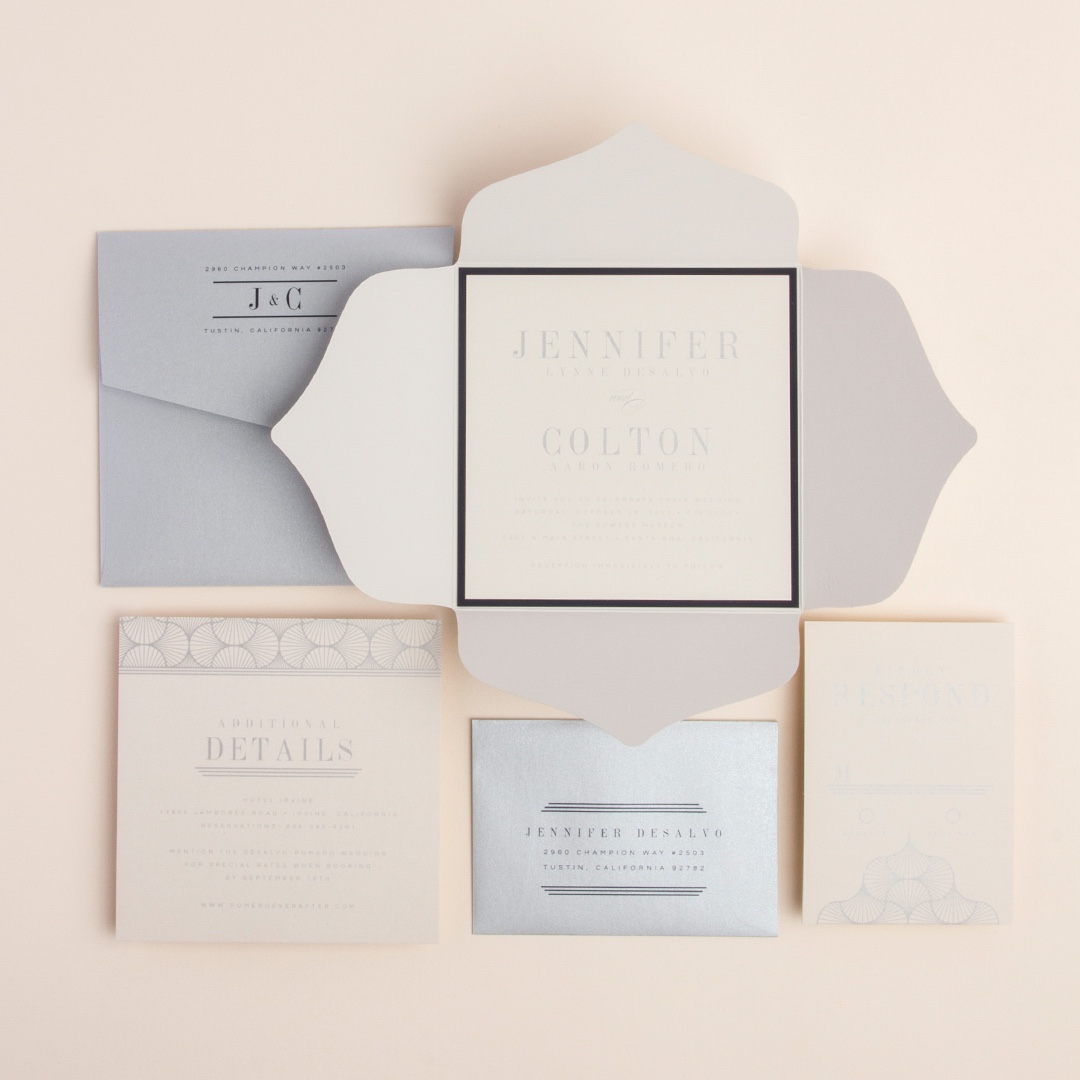 Fancy Fete square petal fold wedding invitation by Envelopments features a beautiful scalloped jacket, pretty art deco style borders and glittering silver accents.