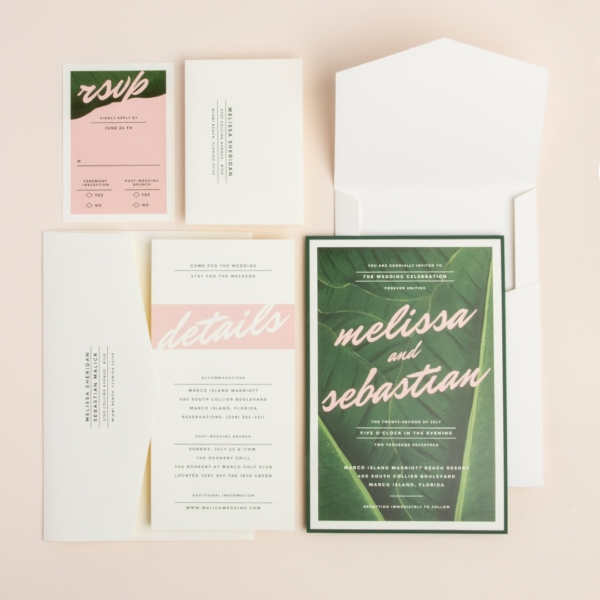 Jungle Palm layered wedding invitation by envelopments features a dramatic palm leaf background with pretty pink accents.