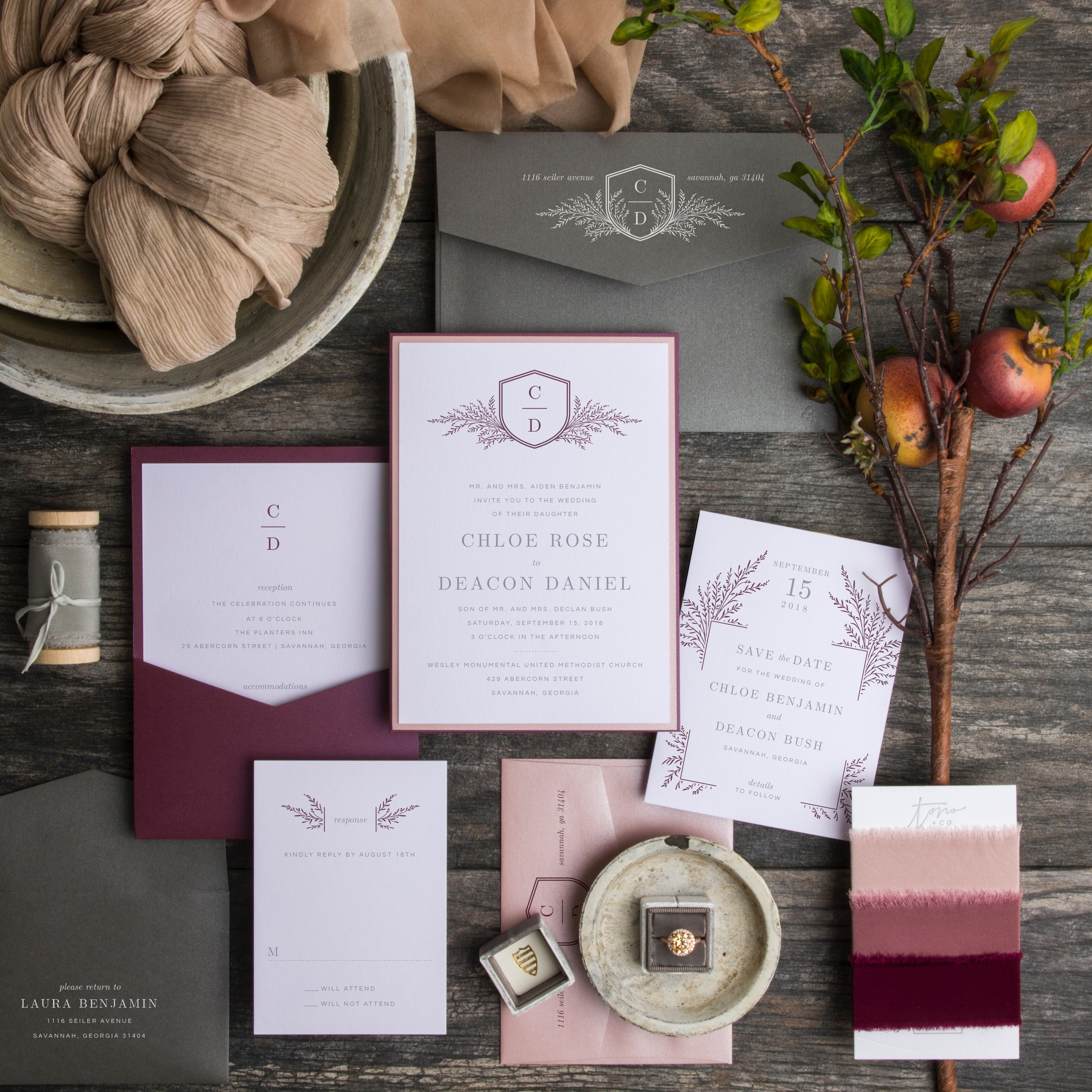 Charmed Life wedding invitation is classic and contemporary.  A modern monogram is neatly displayed in a family crest and embellished with ferns.