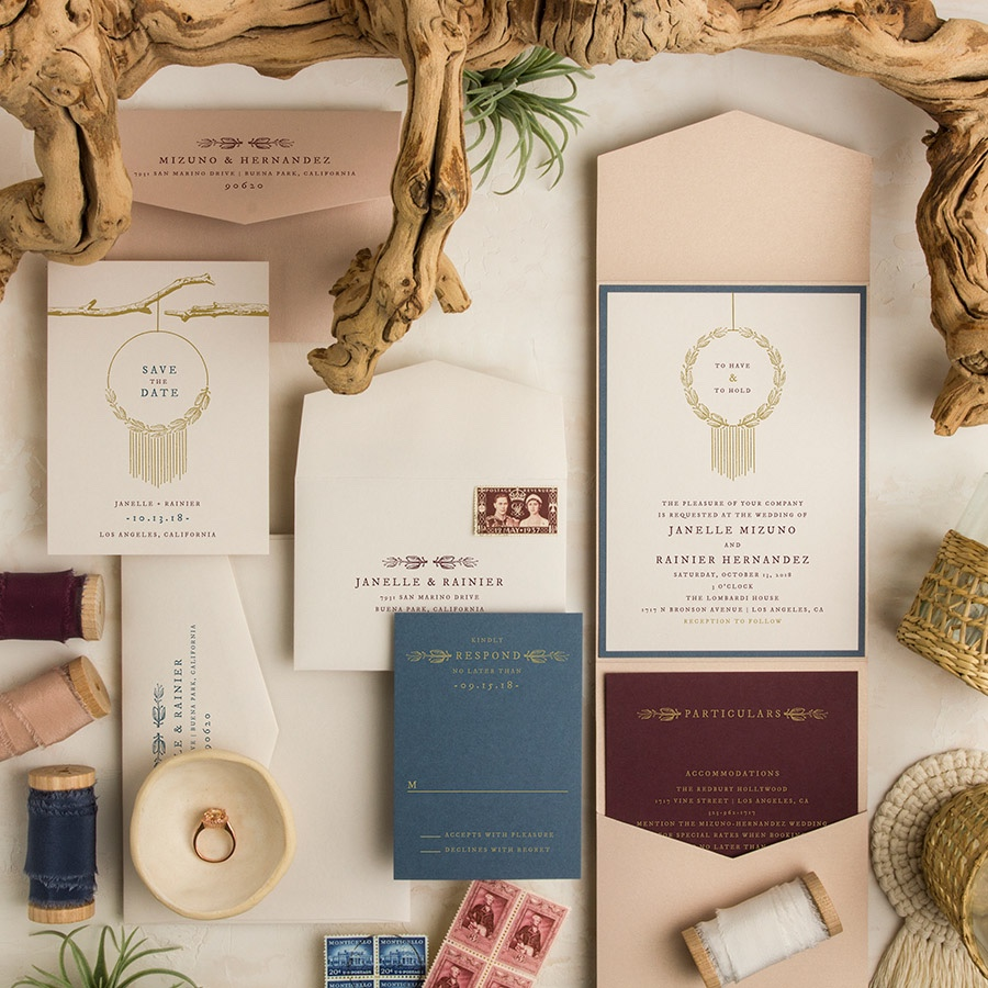 Dream Catcher blue and burgundy pocketfold wedding invitation.
