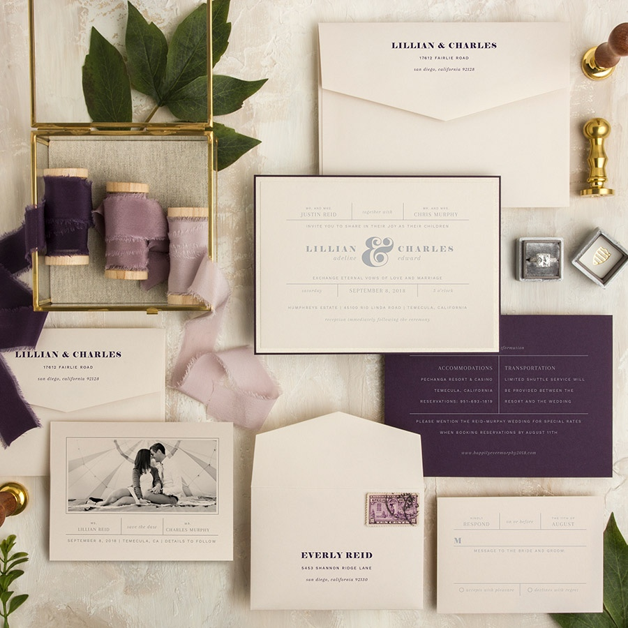 Dropped from the Sky contemporary layered wedding invitation featuring purple and metallic silver ink.