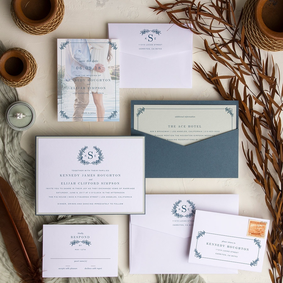 Monogram Wreath contemporary back pocket wedding invitation in slate blue.